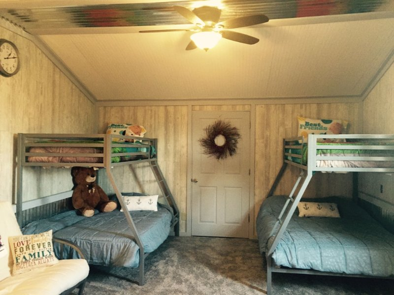Bedroom on 3rd floor with two bunk beds and futon