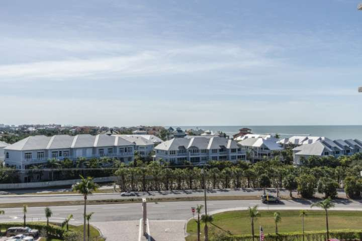 From the living room, you'll enjoy a beautiful view of the Gulf and the million dollar homes along Barefoot Beach.