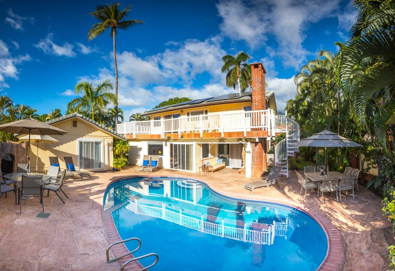 Pool and lanai with  of lounge chairs and two dining tables; BBQ area.