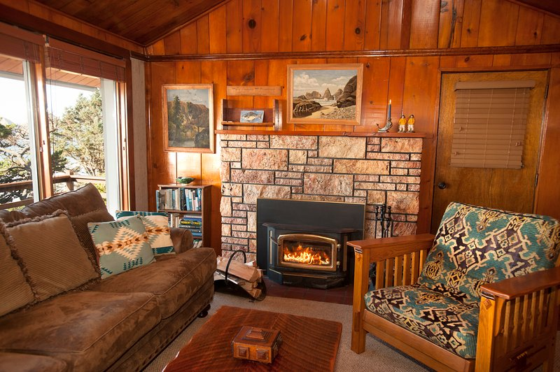 Cozy living room with Knotty pine vaulted ceiling, TV, stereo and wood fireplace
