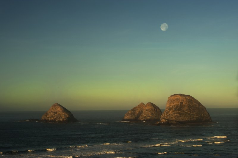 Full moon with view of Oceanside's Three Arch Capes from the unique tree deck