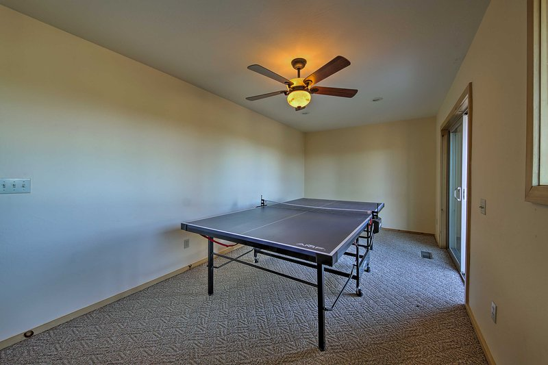 Challenge your companions to a friendly round of ping pong.