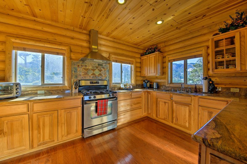 The fully equipped kitchen features ample counter space and stainless steel appliances.