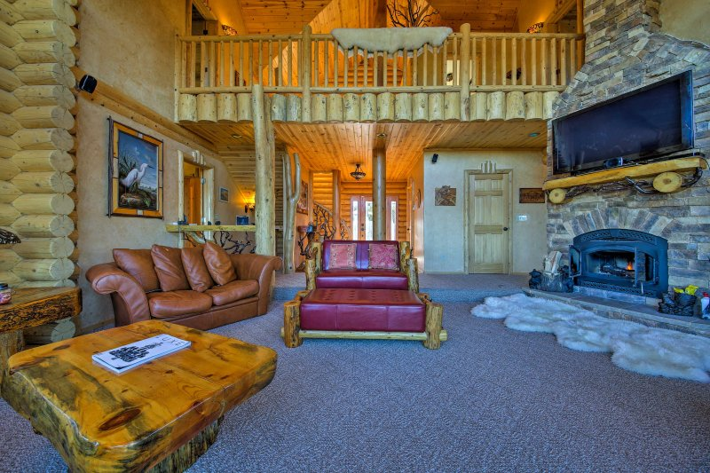 The interior features stunning vaulted ceilings and is decorated with furniture custom built with local wood.