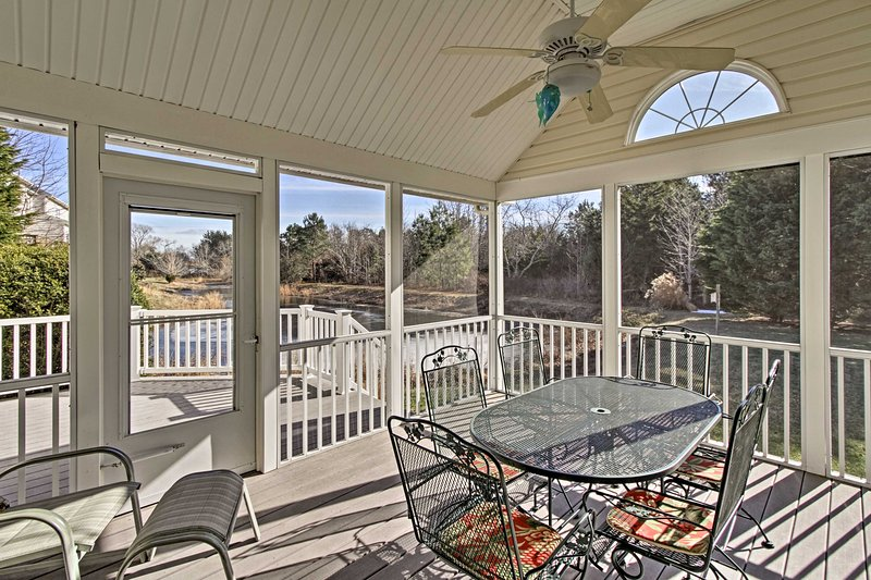 Enjoy sunset dinners in the screened porch with your loved ones.