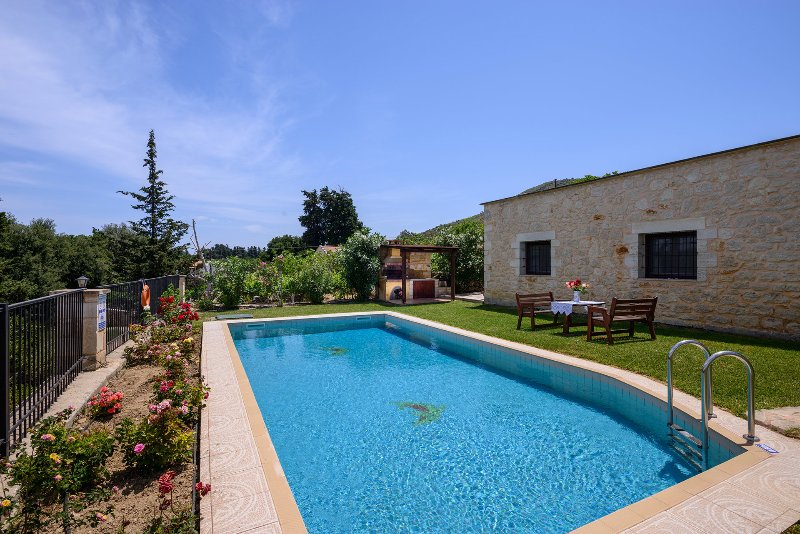 The pool invites you to sit and relax under the sun on hot summer days.