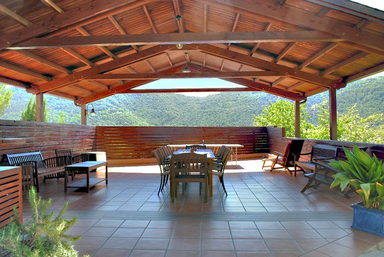 Big wooden covered porch which is ideal for eating outside