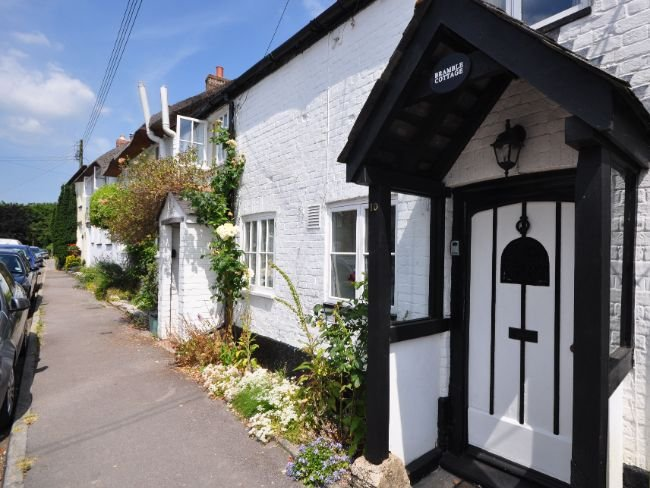 Traditional cottage nestling along the main village road in the heart of Dorset
