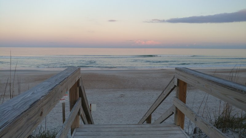 Steps to the beach from Sand Dollar Villas boardwark at sunset