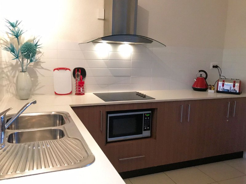 Full sized Kitchen with cooktop and microwave. Full sized family fridge.
