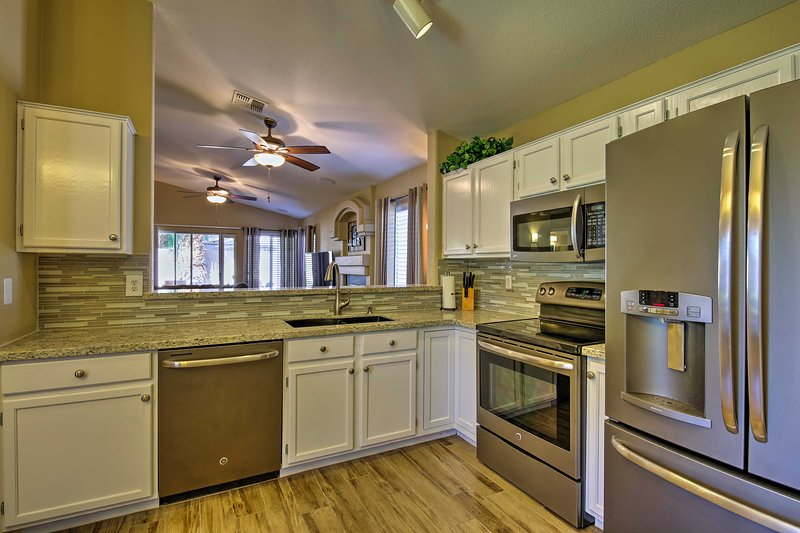 The chic kitchen has stainless steel appliances and granite countertops.