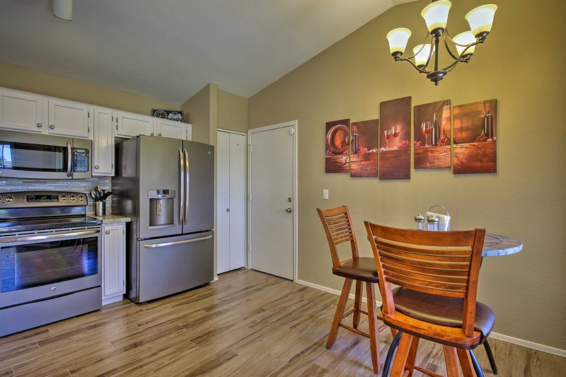 A bar-style bistro table sits in the breakfast nook near the fully equipped kitchen.