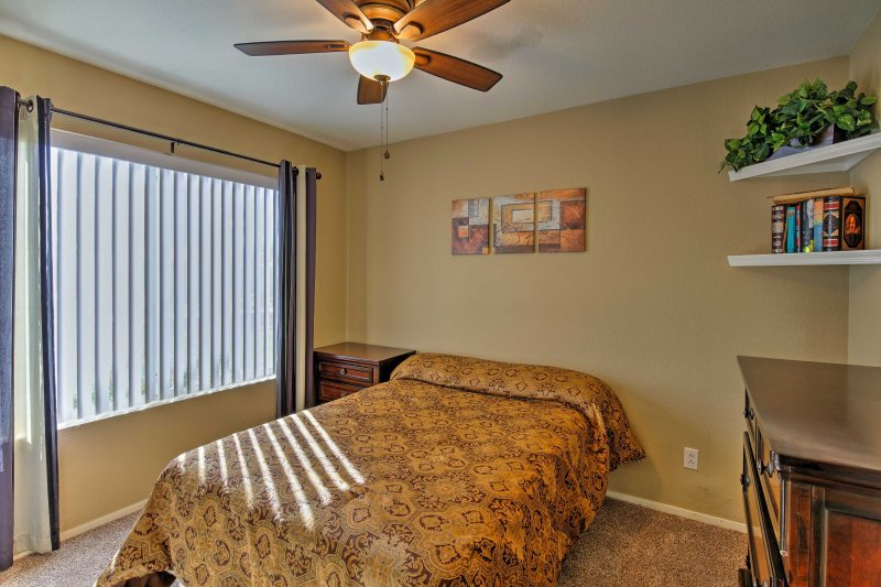 Two travelers can claim this second bedroom complete with a full bed.