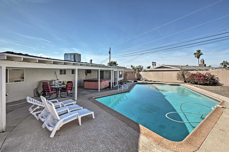 Enjoy the sunshine at this 4-bedroom vacation rental home in Lake Havasu City!