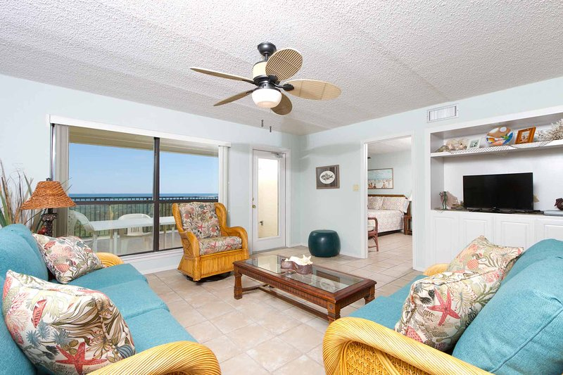 The beautiful living area has a great view of the beach.