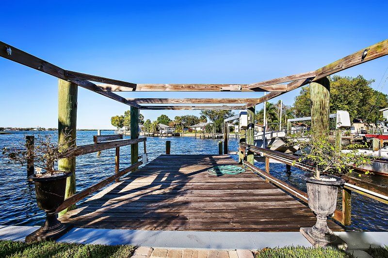 Dock with 10,000lb boat lift. Bring your boat!