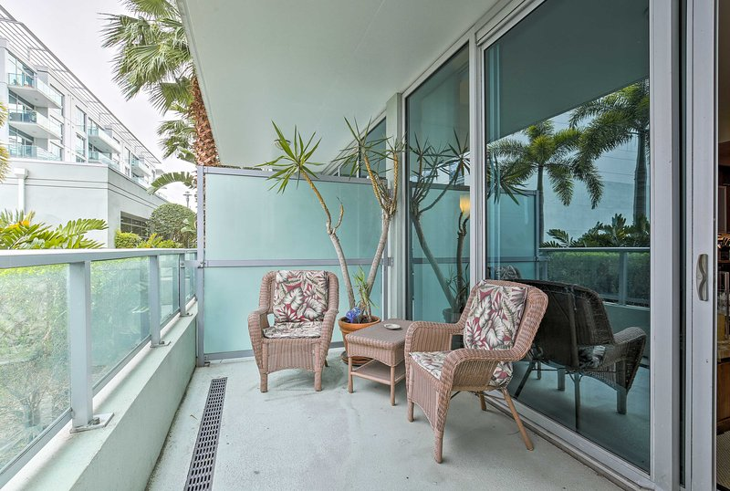 Enjoy beautiful views of the garden and pool from your balcony.