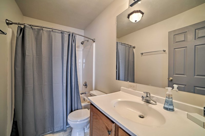 Utilize the single vanity and shower/tub combo featured in the second full bathroom.