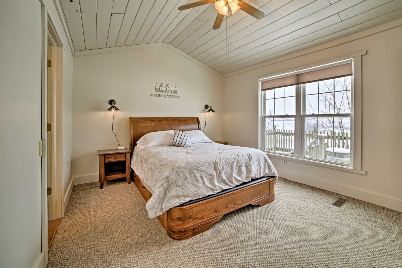 Rest easy on the plush queen bed in the first bedroom.
