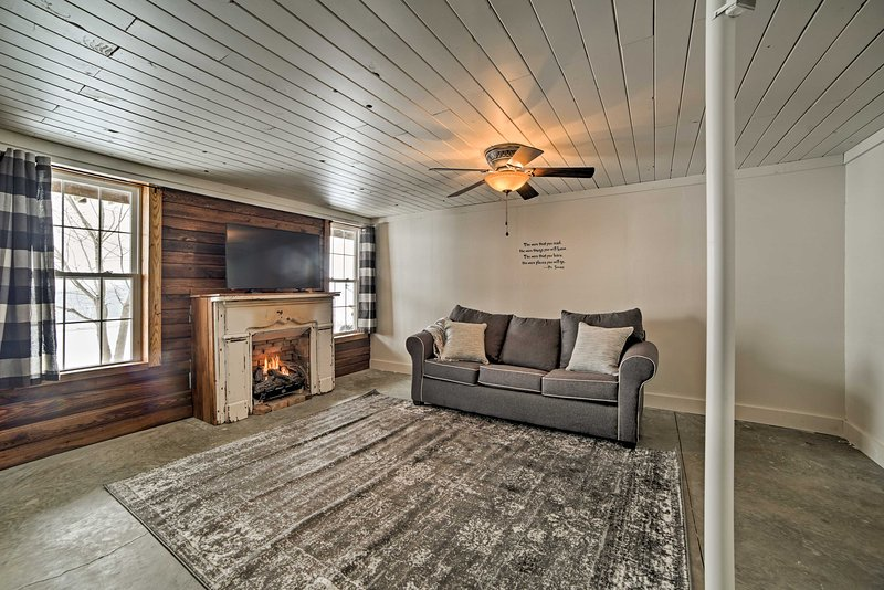 Retreat downstairs to warm up by the gas fireplace and wind down with a movie on the flat-screen TV.