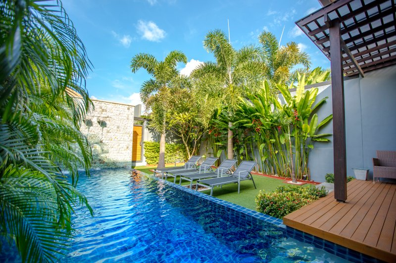 Relax by your private pool in the lush tropical garden of the villa.