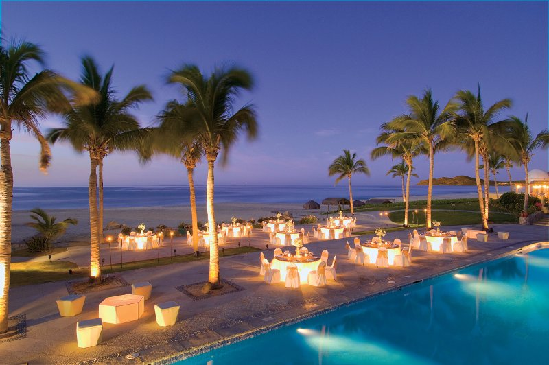 Poolside at night with beautiful view of the Sea of Cortez