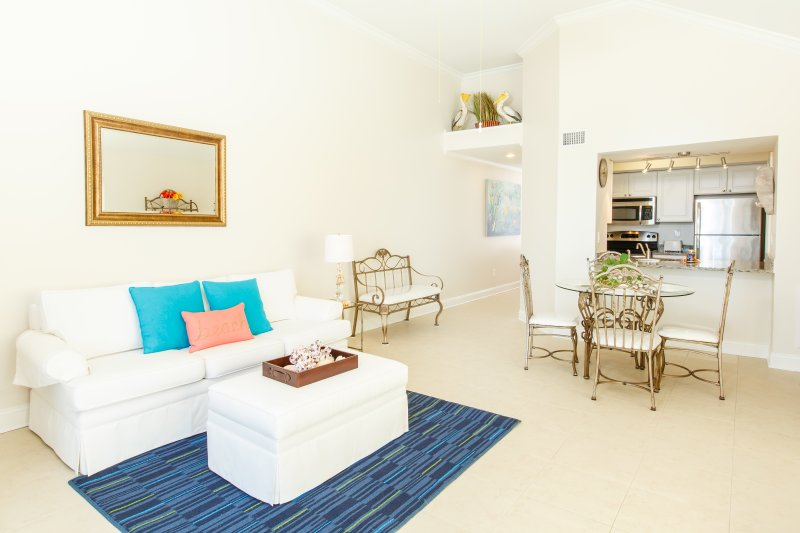Sliding glass doors open to ocean breezes! We freshly painted and renovated!