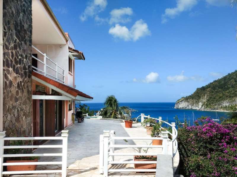 Overlooking the bay of Deshaies and the Caribbean Sea from the pool and terrace. private arrival