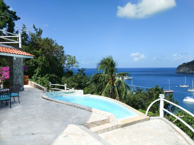 Overlooking the bay of Deshaies and the Caribbean Sea from the pool and terrace