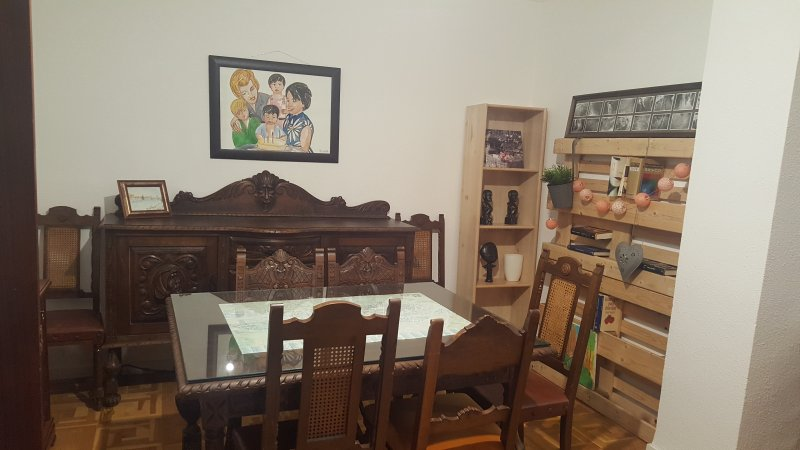 dining area with antique furniture and some books at your disposal.