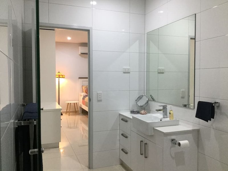 Master bedroom ensuite- double shower, toilet, vanity, towels provided