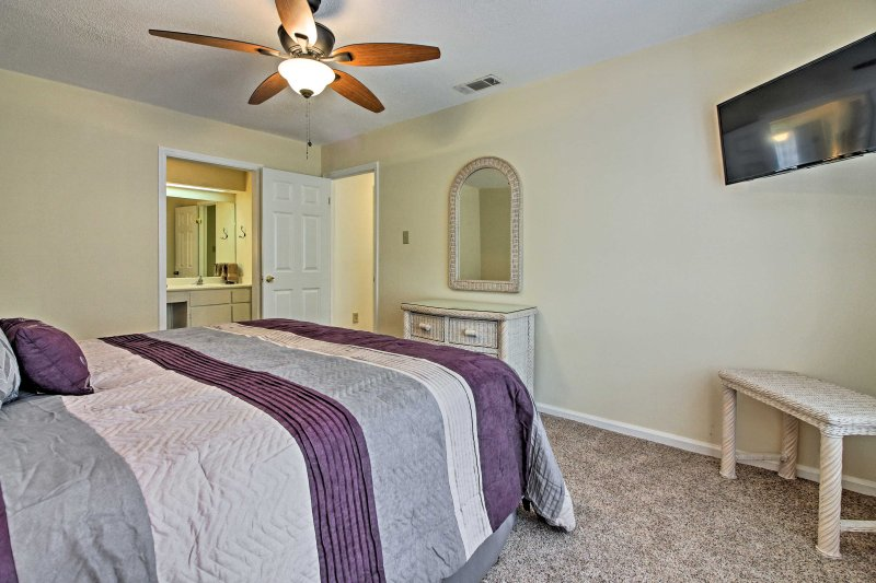 Doze off in this plush king bed while watching shows on the flat-screen cable TV.