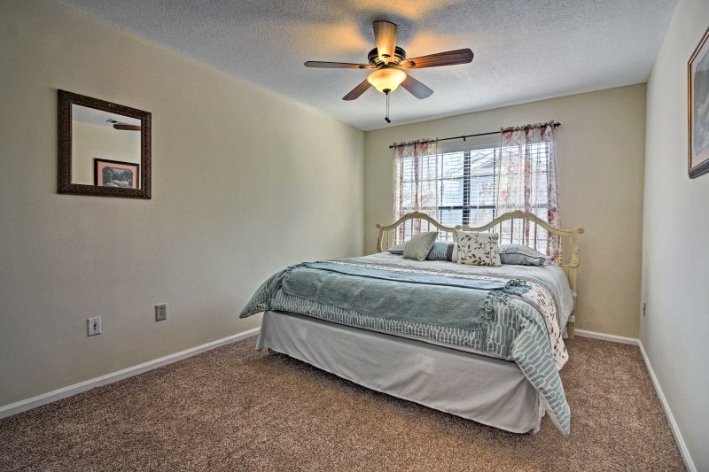 Additional guests will dream easily in this whimsical bedroom with a king bed.