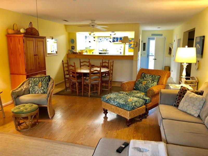 Beachy feel, hardwood flooring in the 2 bedroom villa.