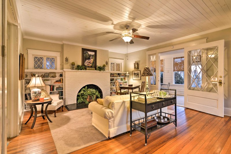 This vacation rental features a gas fireplace and 3-season room for relaxation.