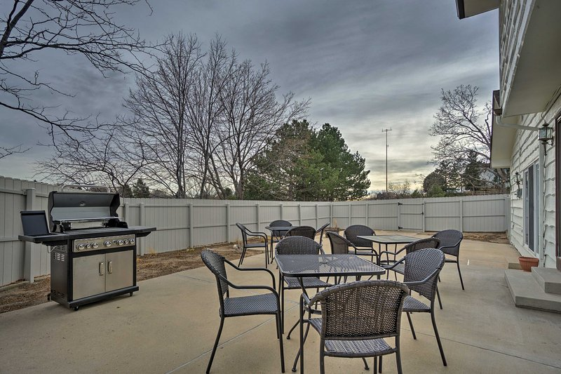 A spacious, fenced-in patio provides the perfect space to dine outdoors.