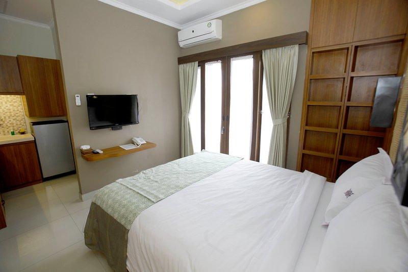 Chambre standard, avec salle de bains et un balcon avec des services hygiéniques