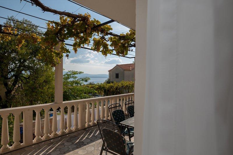 terras met een prachtig uitzicht op zee