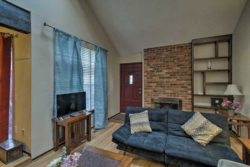 Relax in the living room adorned with a flat-screen TV and fireplace.