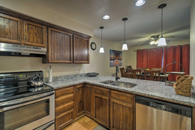 Granite countertops and stainless steel appliances highlight the kitchen.