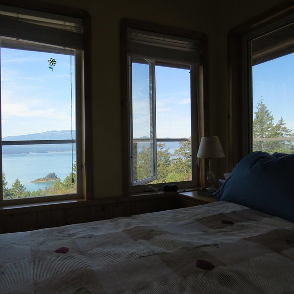 One of Two Master Queen Suites with FANTASTIC view and door out to one of the 3 Wrap-Around Decks!
