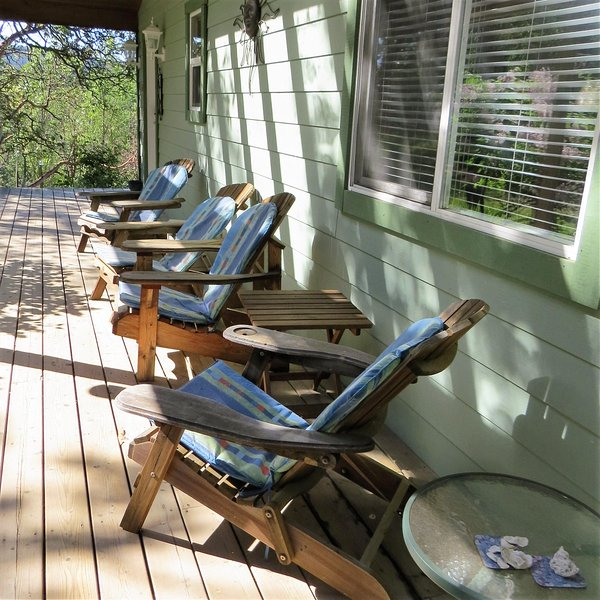 Comfy Adirondack seating on the covered deck!