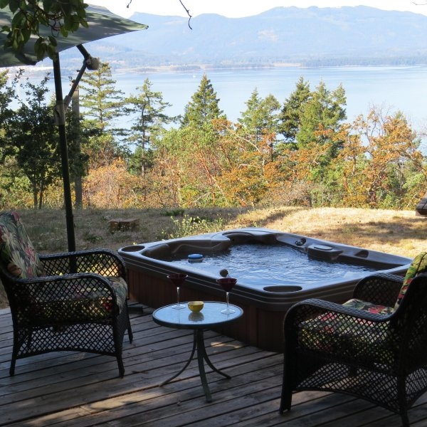 Soak away your aches and pains in the private hot tub!