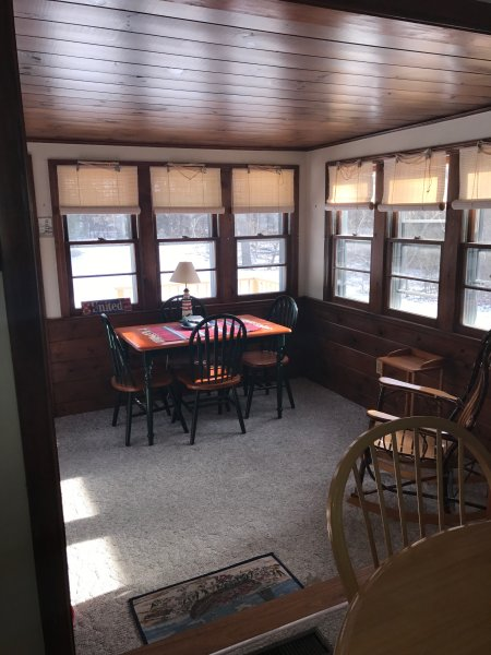 Back sunroom attached to outdoor deck