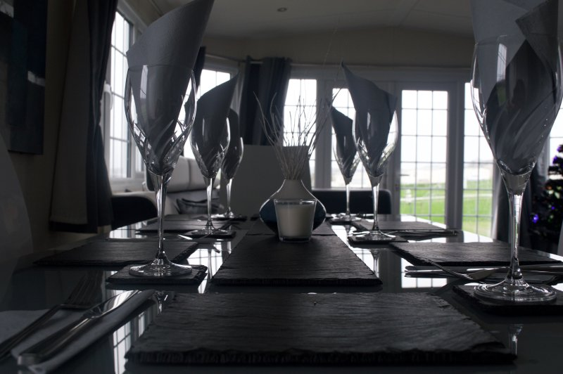 Plenty of room for dinner extending modern 6 seater table with Z shape chairs.