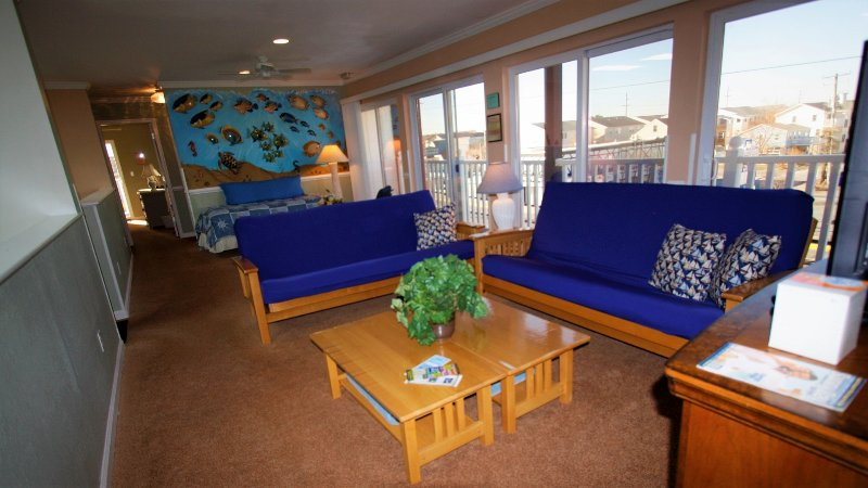 Family Rm with 2 Full size Futons, sheets and pillow cases are stored in Entertainment Center.