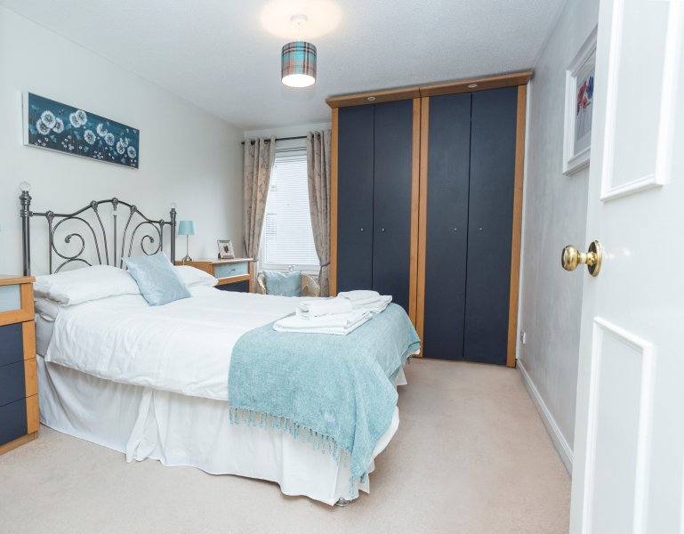 Double bed, lots of storage space and mirrored cupboards