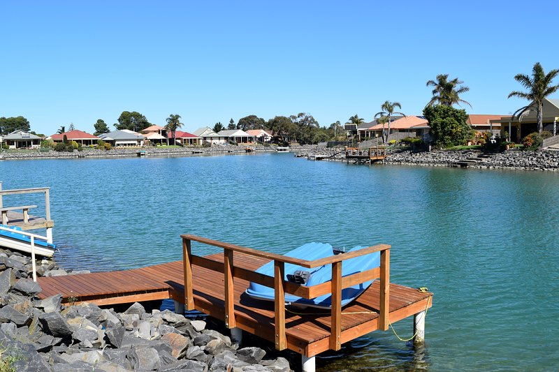 Step outside to your own private jetty and paddleboat