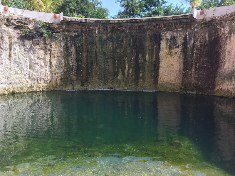 Our private cenote with waterfall right outside our front door