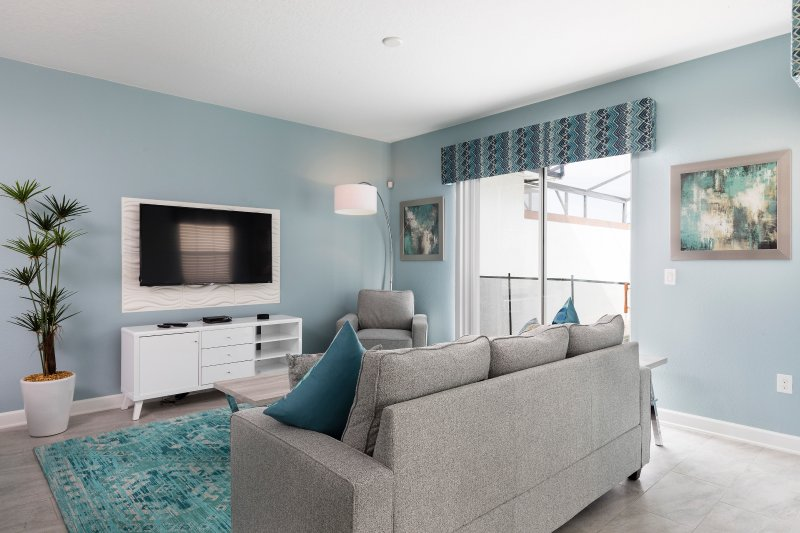 large and furnished living room with TV and sofa at  The retreat at championsgate resort
